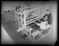 Men work on machinery used at a rehabilitation plant for paroled workers, Los Angeles, 1930s