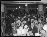Crowd shops at May Company department store during Dollar Day sale, Los Angeles, 1935