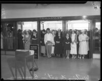Crowd waits to enter Broadway department store during Dollar Day sale, Los Angeles, 1935