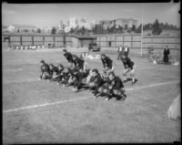 UCLA football team practices their formation on Spaulding Field, Los Angeles, 1930s