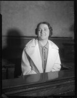 Evangelist Rheba Crawford smiling on the witness stand, Los Angeles, 1935