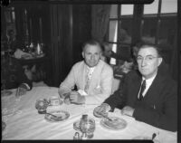 Judge James Francis Thaddeus O'Connor and congressman Thomas Francis Ford sit and eat pie at table, Los Angeles, 1930s