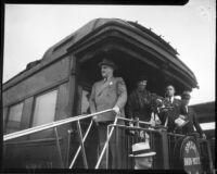 President Franklin D. Roosevelt and Eleanor Roosevelt greet crowd from a train as they arrive, Los Angeles, 1935
