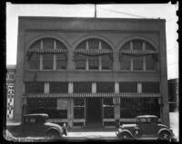 """Two vehicles parked in front of the old """"Post-Record"""" building, Los Angeles, 1930s"""