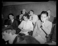 Hal and Myrtle Takaoka, siblings of slain dancer, at a preliminary hearing for their sisters' murder, Los Angeles, 1936