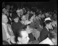 Wrestling fans cheering at an event, Los Angeles, 1936