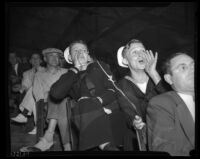Sailors cheering at a wrestling event, Los Angeles, 1936