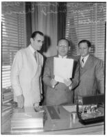 New Universal Pictures Corporation executives William Koenig, Charles R. Rogers and J. Cheever Cowdin at an event, Los Angeles, 1936