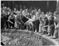 Student being pushed into a fountain during initiation at Los Angeles Junior College, Los Angeles
