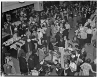 Crowd shops at department store during Dollar Day sale, Los Angeles, 1935