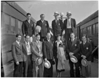 Members of the Olympic Team standing on the platform between two trains, Los Angeles, 1936