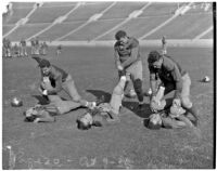 Washington Huskies stretch before a game against the UCLA Bruins at the Coliseum, Los Angeles, 1936