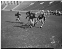 Washington Huskies practice before a game at the Coliseum, Los Angeles, 1936