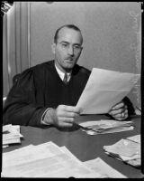 Judge Irvin Taplin looking over paperwork, Los Angeles, 1936