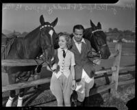 Mary Pickford and Buddy Rogers posing with horses at a ranch, Los Angeles, 1936