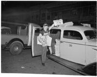 "Newspaper vendor sells issue with the frontpage headline ""Roosevelt Landslide!"" on election night, Los Angeles, 1936"