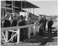 Group of men gathered at Whitney Stables in Santa Anita Park, Arcadia, 1930s