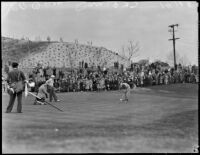 Golfer putts on the green at the 12th annual Los Angeles Open golf tournament, Los Angeles, 1937