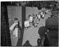 Women and children picket outside of the Works Progress Administration during a sit-down strike, Los Angeles, 1936