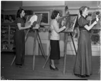 Three women practice their painting skills at the Otis College of Art and Design, Los Angeles, 1930s