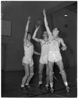Black-Foxe Military Institute students in uniform on the basketball court for their traditional competition against Cumnock School, Los Angeles, 1937