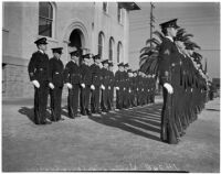 Harvard Military Academy cadets standing in two lines outside a building, Los Angeles