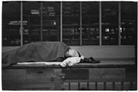 Man sleeping at the Douglas Aircraft Corporation plant where workers participated in a sit-down strike, Santa Monica, 1937