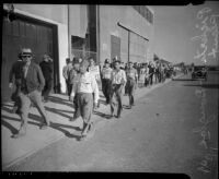 Men marching at the Douglas Aircraft Corporation plant where workers participated in a sit-down strike, Santa Monica, 1937