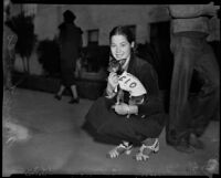 Woman and dog supporting the C.I.O. at a strike rally, Santa Monica, 1937
