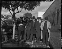 Group of unidentified men and a policeman involved with the Douglas Aircraft Corporation plant strike, Santa Monica, 1937