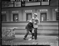 """Julius """"Groucho Marx and Leonard """"Chico"""" Marx performing during filming for """"A Day at the Races,"""" Los Angeles, 1937"""