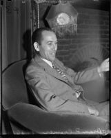 Oran P. Cremer in an armchair, Los Angeles, 1930s