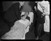 District Attorney Buron Fitts on a stretcher after being shot, Los Angeles, 1937