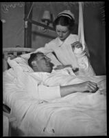 Buron Fitts in the hospital with a gunshot wound being tended to by a nurse, Los Angeles, 1937