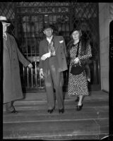 Buron Fitts leaving the hospital with his wife after recovering from an assassination attempt, Los Angeles, 1937