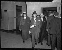Buron Fitts leaving the hospital after recovering from an assassination attempt, Los Angeles, 1937