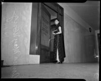 Film actress Anna May Wong entering District Attorney Buron Fitts' office, Los Angeles, 1937