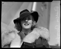 Actress Phyllis Brooks wearing a fur-lined coat and fedora, Los Angeles, 1937