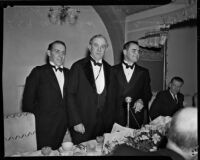 John Anson Ford, Tom Connolly and Peirson M. Hall dressed in tuxedos at a banquet, Los Angeles, 1930s