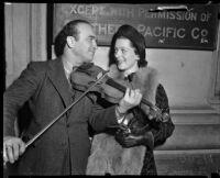 Violinist David Rubinoff serenading radio singer Virginia Verrill, Los Angeles, 1937