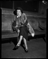 Radio singer Virginia Verrill awaiting violinist David Rubinoff in a lobby, Los Angeles, 1937