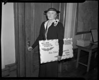 Postmistress Mary D. Briggs holding a giant envelope, Los Angeles, 1936