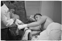 Boxer Bob Nestell getting his hand taped up before a fight, Los Angeles, 1937