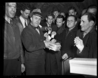 Douglas Aircraft Corporation workers on strike put ballots into box, Santa Monica, 1937