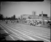 Track athletes race during the All-City High School track and field meet, Los Angeles, 1937