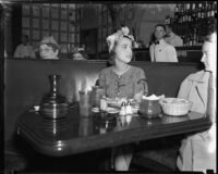 Heiress Nancy Pierson Brooks Macy Brill eating at a cafe, Los Angeles, 1937