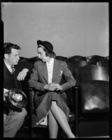 Heiress Nancy Pierson Brooks Macy Brill sitting next to an unidentified man, Los Angeles, 1937