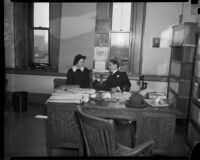 Cult victim Delight Jewett and U.S. Attorney Fleet Palmer in his office, Los Angeles, 1937