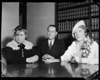 Evangelist Aimee Semple McPherson with her nurse Ella Nordin and her business manager Giles Knight in her attorney's office, Los Angeles, 1937