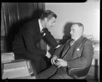 Film actor Clark Gable speaking with his father W.H. Gable, Los Angeles, 1937